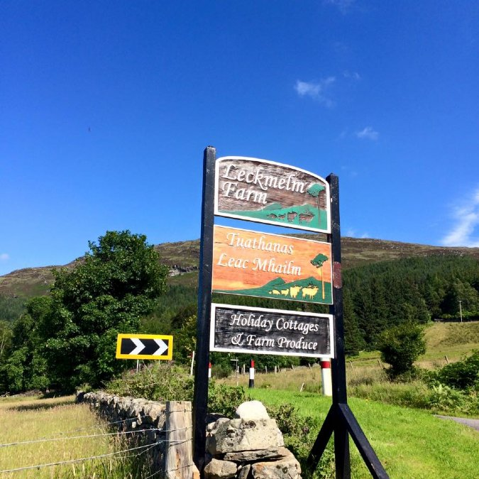Sign post to Leckmelm Holiday Cottages near Ullapool