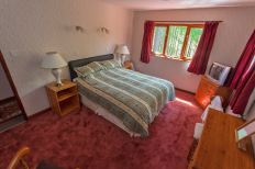 Leckmelm House holiday home double room with king size bed.
