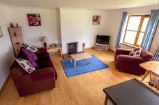 Living Room in Lochside Cottage 1 at Leckmelm Holiday Cottages near Ullapool