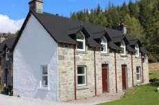 Exterior view of beautiful stone fronted Campbelltown Cottage No 5 on Leckmelm Estate - Self Catering cottage
