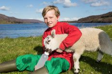 Duncan on Leckmelm Farm with a pet lamb